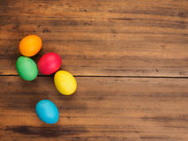 Easter eggs on old brown wood background. Top view, horizontal. Mock up for your greetings card, poster or other design Stock Photography