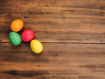 Easter eggs on old brown wood background. Top view, horizontal. Mock up for your greetings card, poster or other design Royalty Free Stock Image