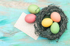 Easter eggs and old greetings card vintage toned Royalty Free Stock Images