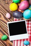 Easter eggs and an old picture frame Royalty Free Stock Photos