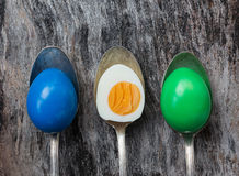 Easter eggs in old spoons on wooden background Stock Photo