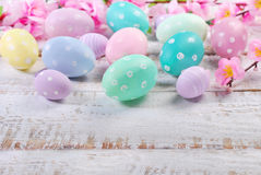 Easter eggs on old wooden background with space for text Stock Photos