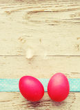 Easter eggs on old wooden background. Stock Image