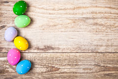 Easter eggs on old wooden board Stock Photos