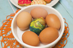 Easter Eggs - One Easter egg among other plain Royalty Free Stock Photo