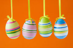 Easter eggs on orange background Royalty Free Stock Image