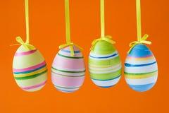Easter eggs on orange background Royalty Free Stock Image