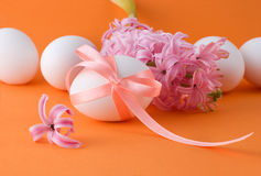 Easter eggs on an orange background Stock Photos