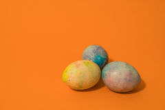 Easter Eggs on Orange Background Royalty Free Stock Images