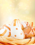 Easter eggs in orange tones Stock Images