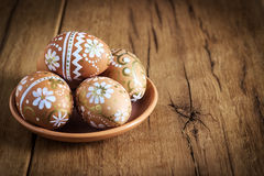 Easter eggs with ornament on wooden Stock Images