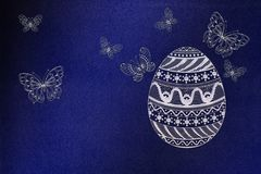 Easter eggs with ornaments. And butterflies stock images