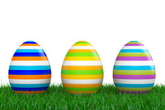 Easter Eggs over Grass. 3d Rendering. Easter Eggs over Grass on a white background. 3d Rendering Royalty Free Stock Photos