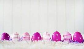 Easter eggs over white striped background Stock Photography