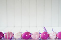 Easter eggs over white striped background Royalty Free Stock Photo