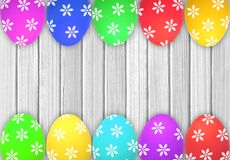Easter eggs over white wooden table Royalty Free Stock Images