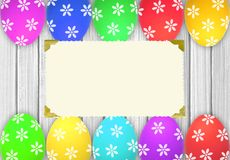 Easter eggs over white wooden table and blank card Stock Photos