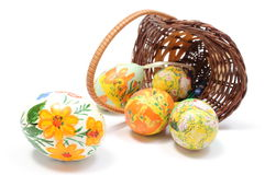 Easter eggs in overturned wicker basket Stock Image