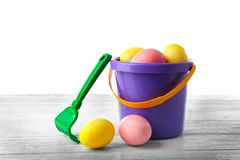 Easter eggs with pail. On white background Stock Photography