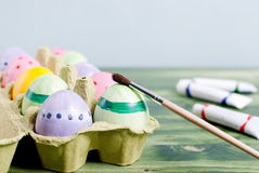 Easter eggs and paint brush Royalty Free Stock Photography