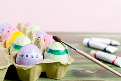 Easter eggs and paint brush Stock Photography