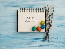 Easter eggs painted in bright colors on a blue background. Top view, close-up, isolated. Happy Easter. Preparation for the holiday royalty free stock photography