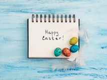 Easter eggs painted in bright colors on a blue background. Top view, close-up, isolated. Happy Easter. Preparation for the holiday royalty free stock image