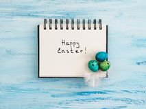 Easter eggs painted in bright colors on a blue background. Top view, close-up, isolated. Happy Easter. Preparation for the holiday royalty free stock photo
