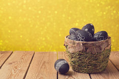 Easter eggs painted with chalkboard paint over yellow background Stock Image