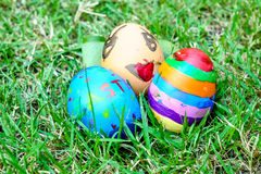 Easter eggs painted by child. On green grass stock photo