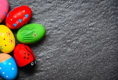 Easter eggs painted colorful on dark background top view copy space royalty free stock image