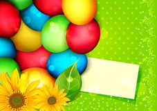 Easter eggs painted with a congratulatory card Royalty Free Stock Photos