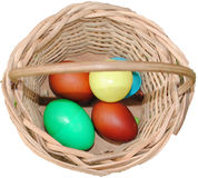 EASTER EGGS. These eggs painted in different colors presented in a basket contain enough vitamins giving a mad desire to eat of consumers Royalty Free Stock Photo