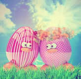 Easter eggs painted, with flowers, over blue sky Stock Image