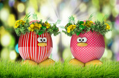 Easter eggs painted, with flowers over spring background Stock Image