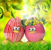 Easter eggs painted, with flowers over spring background Royalty Free Stock Images