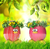 Easter eggs painted, with flowers over spring background Stock Photography