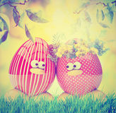 Easter eggs painted, with flowers,  vintage instagram filters. Easter eggs painted, with flowers over spring natural green background, retro vintage instagram Royalty Free Stock Photos