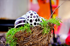 Easter Eggs painted by hand with black and white in real nest Stock Photo
