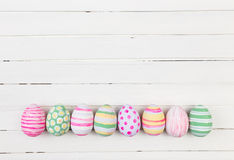 Easter eggs painted in pastel colors on a white wood Stock Photography