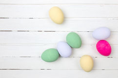 Easter eggs painted in pastel colors on white wood Royalty Free Stock Image