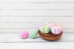Easter eggs painted in pastel colors on white wood Stock Photos
