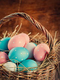 Easter Eggs Painted with peas lies in a basket Stock Photos