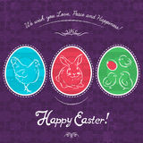 Easter eggs painted with rabbit, hen and chicken. Royalty Free Stock Photos