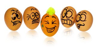Easter eggs, painted in smiling and terrified cartoon faces look. Easter eggs, painted in smiling and terrified cartoon faces. Decorated eggs with funny colorful Royalty Free Stock Images