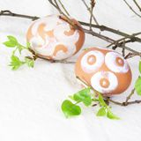Easter Eggs Painted with Sugar Fudge. Easter Brown Eggs Painted with White Sugar Fudge Stock Image