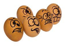 Easter eggs, painted in a terrified cartoon funny faces of a guy royalty free stock image