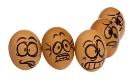 Easter eggs, painted in a terrified cartoon funny faces of a guy. Easters egg, painted in a terrified cartoon funny faces of a guys. Decorated scared eggs in a Stock Image
