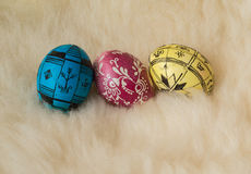 Easter eggs painted in the traditional way. Lying on sheep's fur Stock Image