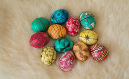 Easter eggs painted in the traditional way. Lying on sheep's fur Royalty Free Stock Images